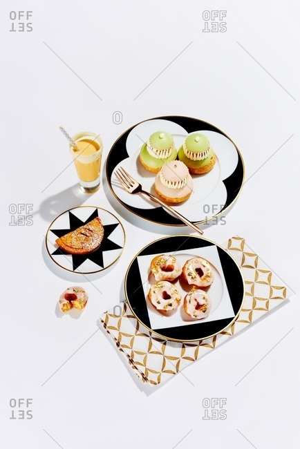 Trio of fancy desserts on white background