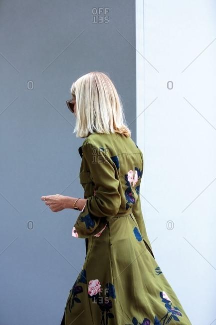 Paris, France - March 14, 2017: Woman wearing green floral dress at Paris Fashion Week
