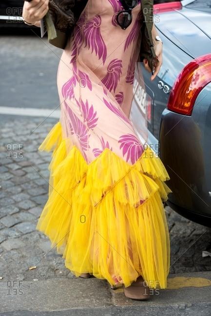 Paris, France - March 14, 2017: Woman wearing stylish yellow and purple dress