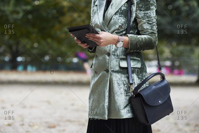 Woman wearing green crushed velvet jacket, horizontal crop
