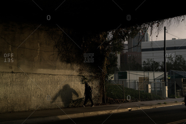 A man walks below an underpass in Los Angeles, California