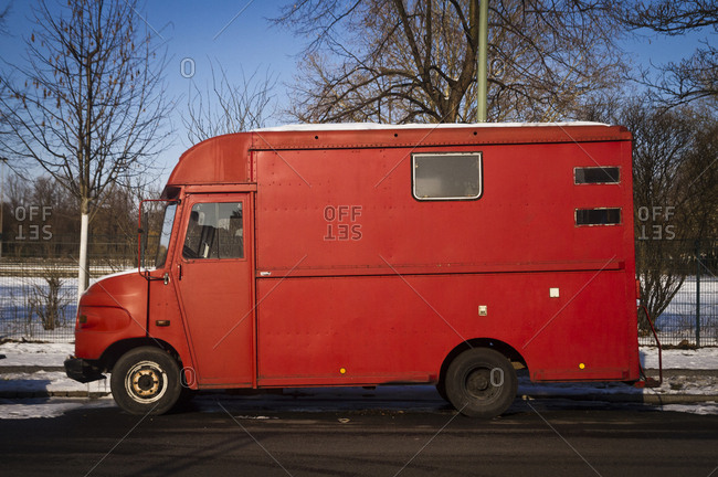 Berlin, Germany - March 13, 2013: A parked red van