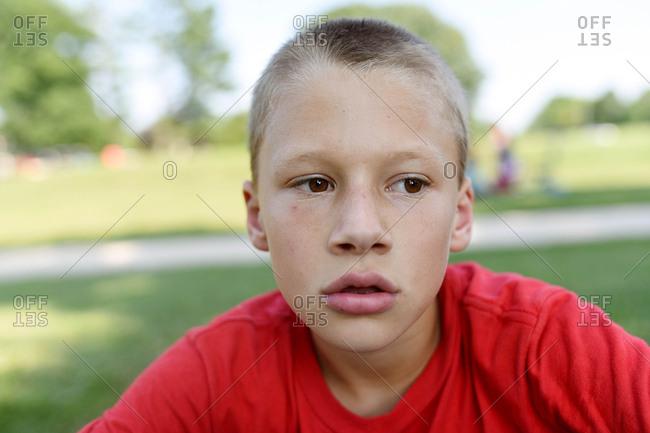 Close up of a boy wearing a red shirt