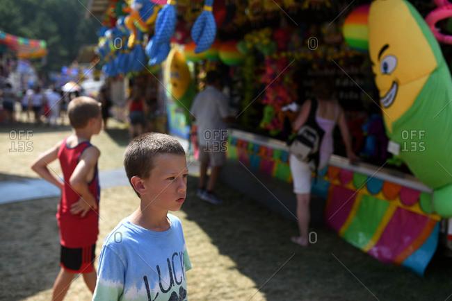 Boys walking towards games at a fair