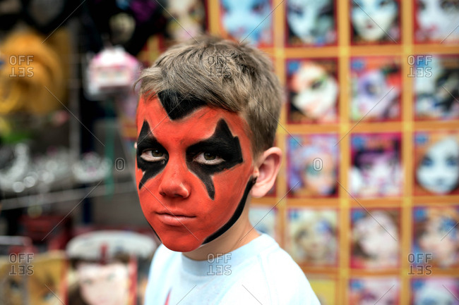 Boy with red and black face paint