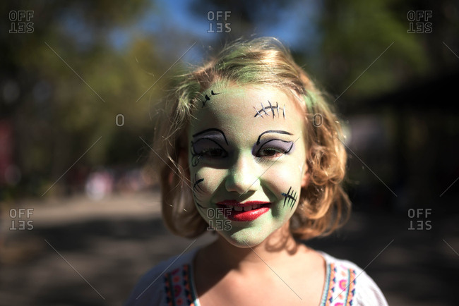 Girl with Frankenstein face paint