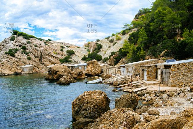 Beach Es Portitxol with typical fishermen houses in Ibiza, Balearic Islands, Spain