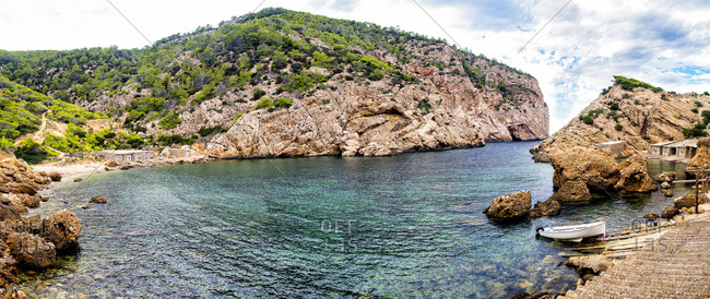 Ibiza, Balearic Islands, Spain - September 15, 2016: Beach Es Portitxol with typical fishermen houses in Ibiza, Balearic Islands, Spain
