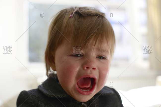 Young girl crying passionately