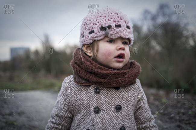 Pretty little girl in winter with a dreamy look