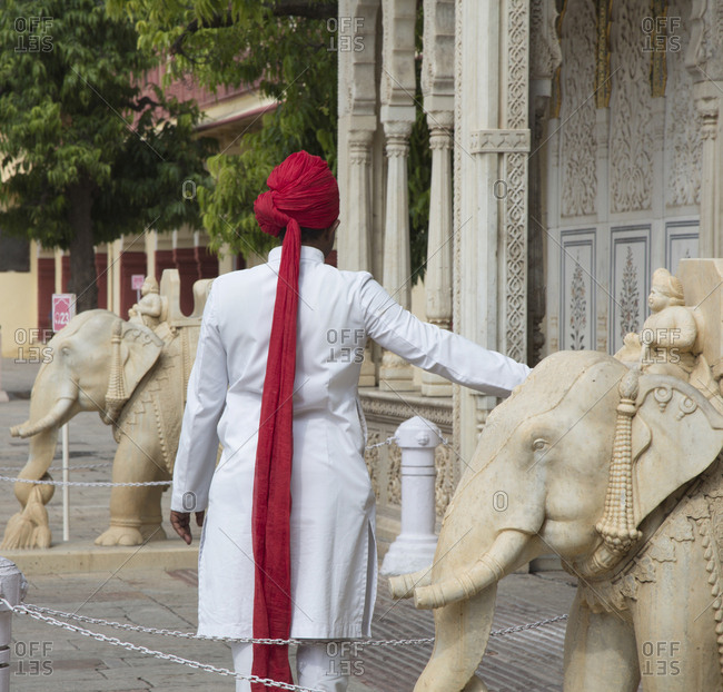 Tour guide by an elephant statue at the City Palace, Jaipur, India