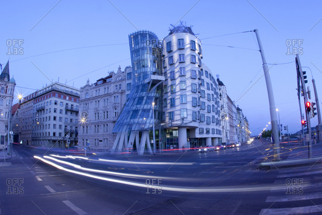 Prague, Czech Republic - May 25, 2011: Dancing house with passing traffic in Prague at dusk