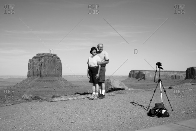Four Corners, USA - May 26, 2010: German tourists taking photograph at Monument Valley Navajo Tribal Park