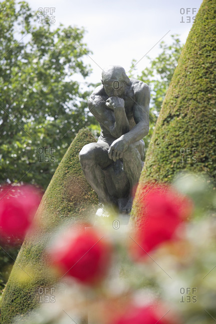 Paris, France - July 14, 2009: The Thinker statue in the garden at the Rodin museum