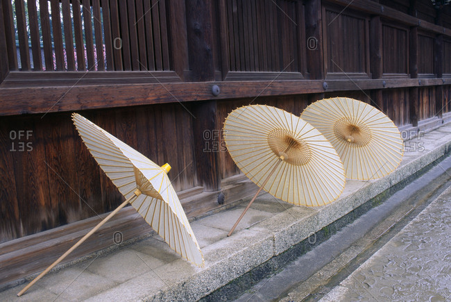 Three paper umbrellas drying near temple, Kyoto, Japan