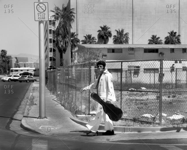 Las Vegas, Nevada - April 25, 2011: Elvis impersonator walking on a corner in Las Vegas