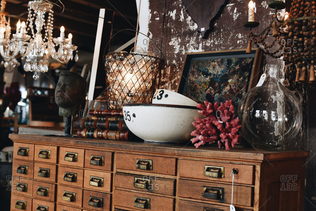 Antiques and collectibles for sale on a wooden apothecary chest