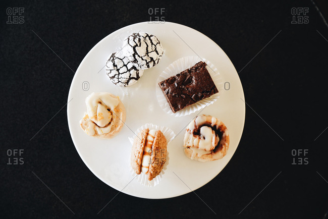 Variety of baked goods on a circular white plate