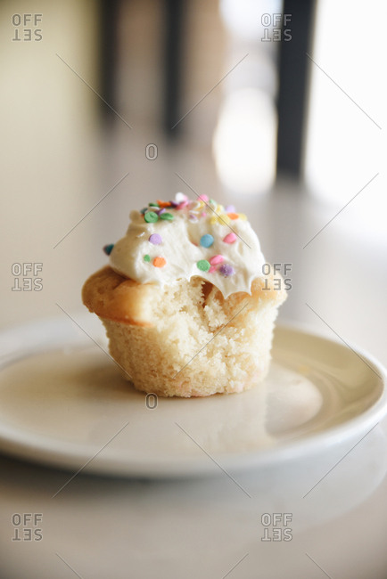 Cupcake with confetti sprinkles on a plate