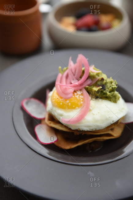 Guacamole and egg on a fried tortilla in a bowl