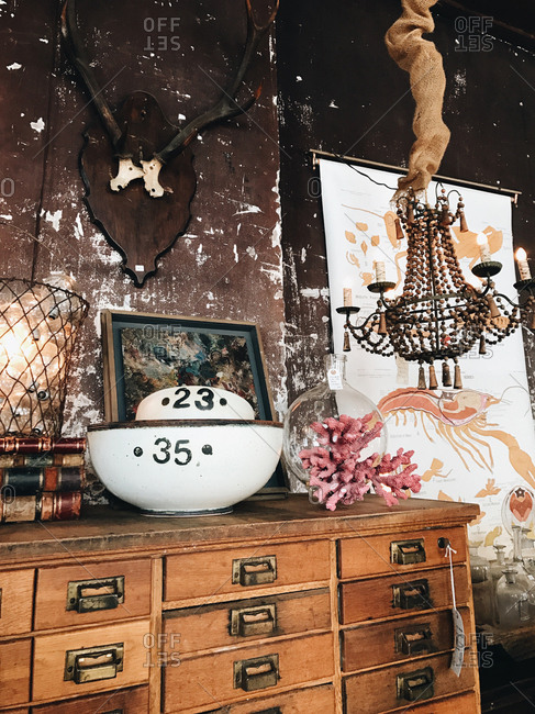 Apothecary chest, rustic chandelier and collectibles for sale at an antique shop