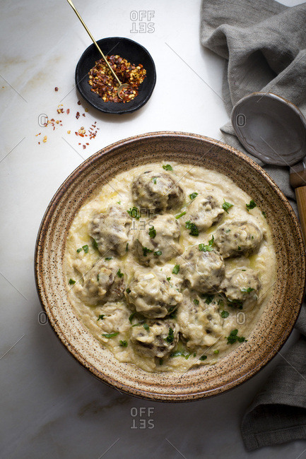 Swedish meatballs with brown gravy in a ceramic bowl
