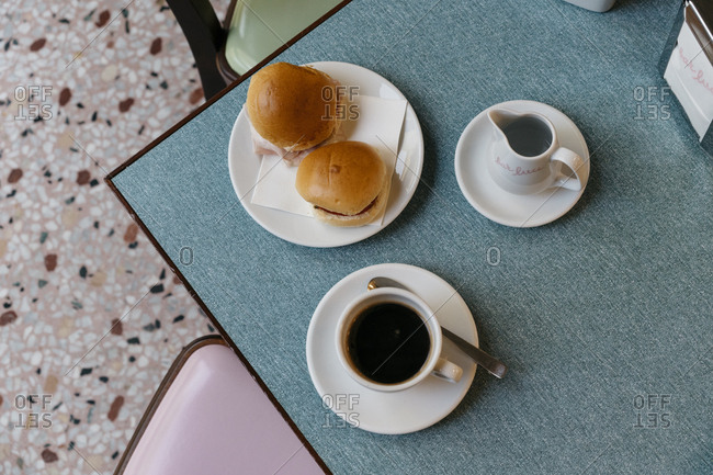 Milan, Italy - November 21, 2016: Breakfast sandwiches served with coffee