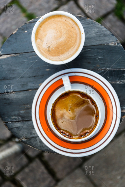 Espresso drinks at small wooden table