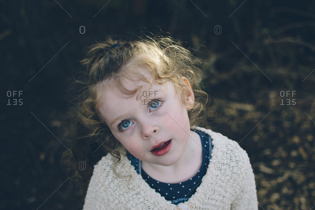 Beautiful toddler girl gazes upward