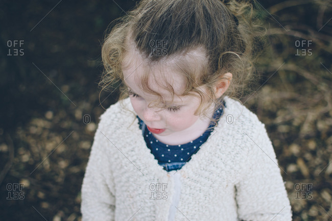 Elevated view of toddler girl with curly hair