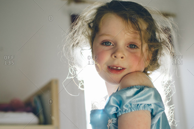 Backlit view of preschool aged girl in princess dress