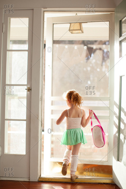 Girl walking out door in her ballet outfit