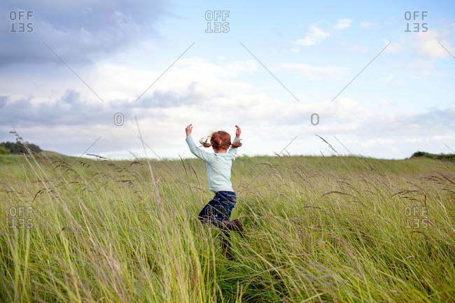 Girl dancing in a field