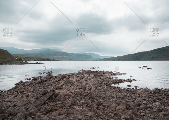 Rugged rocky shore by waterway