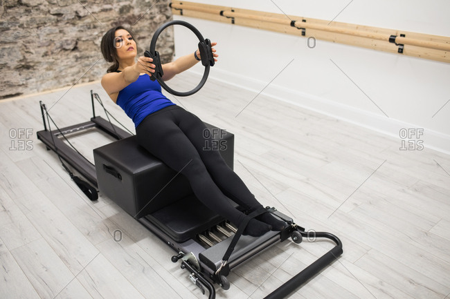 Woman exercising with exercising ring