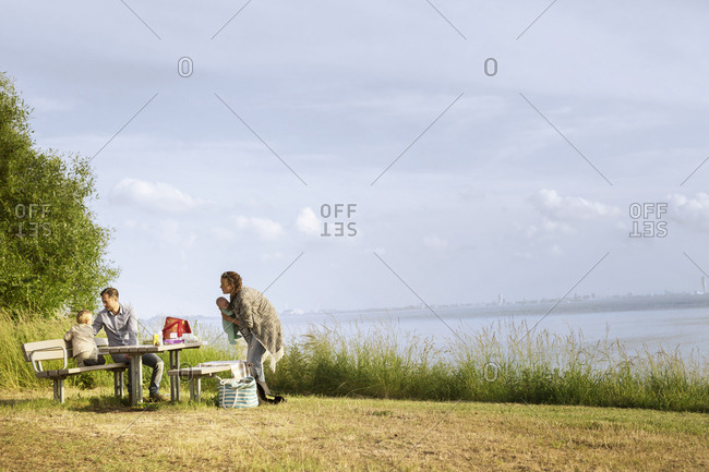 Family resting by sea