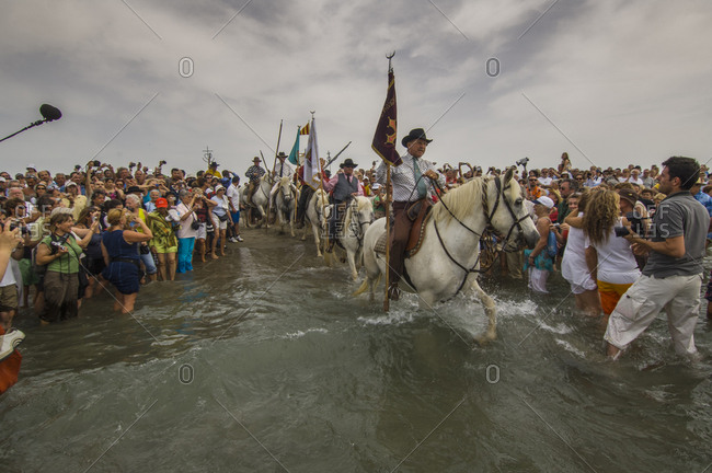 Camargue, France - March 4, 2017: Procession during annual gipsy pilgrimage at St. Marie de la Mer
