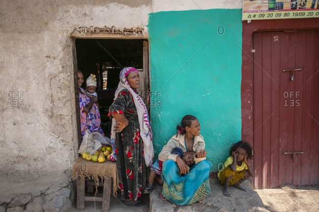 Welo, Ethiopia - November 30, 2010: Group of people in the shade at the daily market of Asayta