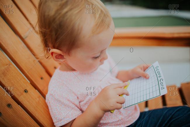 Girl with mini golf score card