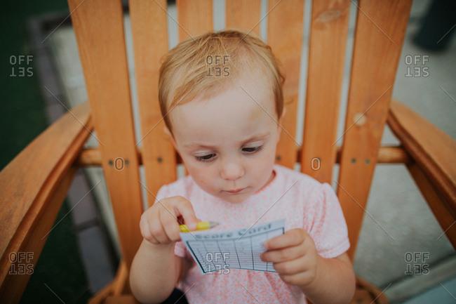 Girl with a mini golf score card