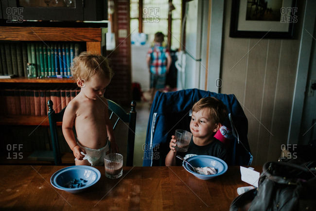 Toddler with boy having a snack