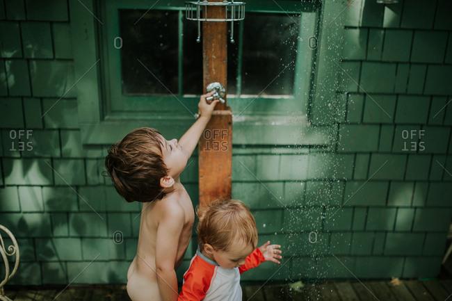Kids using an outdoors shower