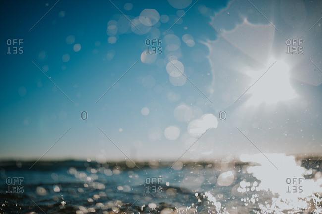 Sun dappled water through wet lens