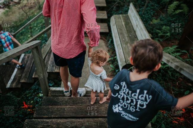 Man with kids going down coastal steps