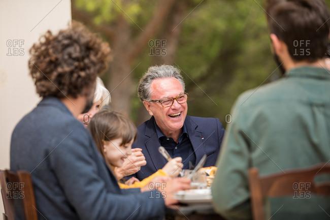 Family eating alfresco
