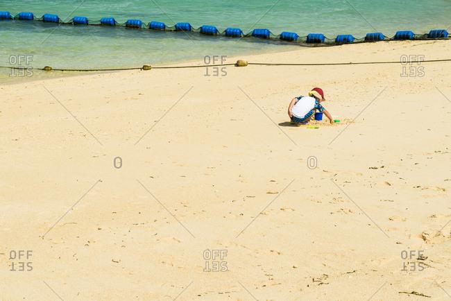 Little boy playing on the Zanpa beach
