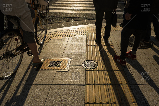 Osaka, Japan - March 21, 2016: Shadow of people on crosswalk, Japan