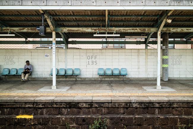 Osaka, Japan - April 9, 2016: Railroad station platform