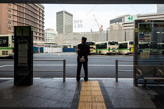 Osaka, Japan - April 19, 2016: Bus terminal guard in Osaka