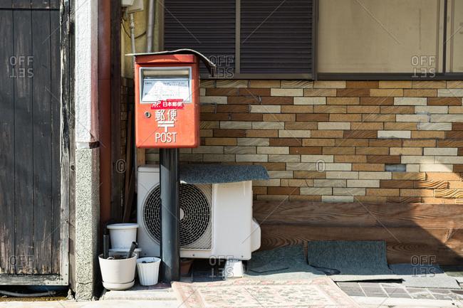 Osaka, Japan - September 10, 2016: Japan post mailbox on a street